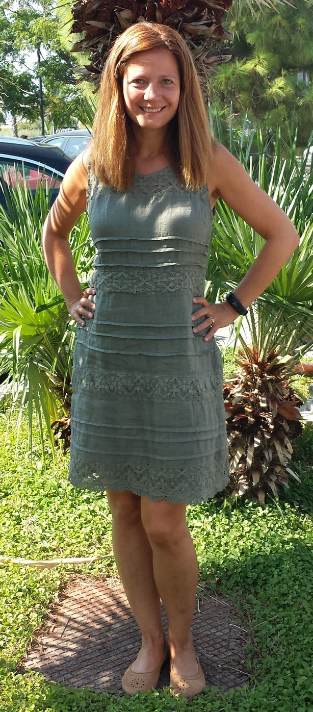 Me standing outside in a green dress